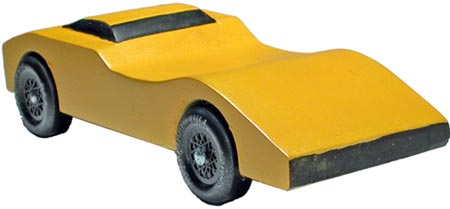 Banshee pinewood derby car painted yellow with black trim.