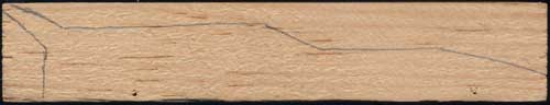 Traced design on a Pinewood Derby car block