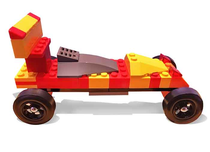 Gray cockpit on a red and yellow LEGO pinewood derby car