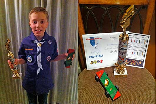 Pinewood derby winner with trophy