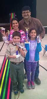 Two Pinewood Derby Winners with trophies.